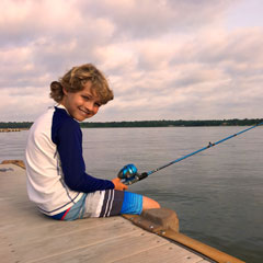 boy fishing long cove pier cedar creek lake tx