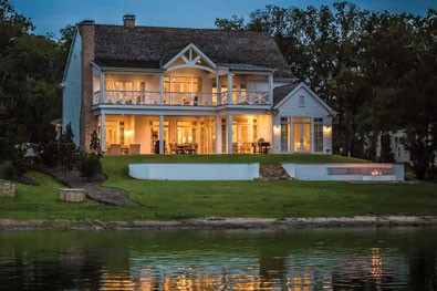 custom waterfront lake home at dusk long cove