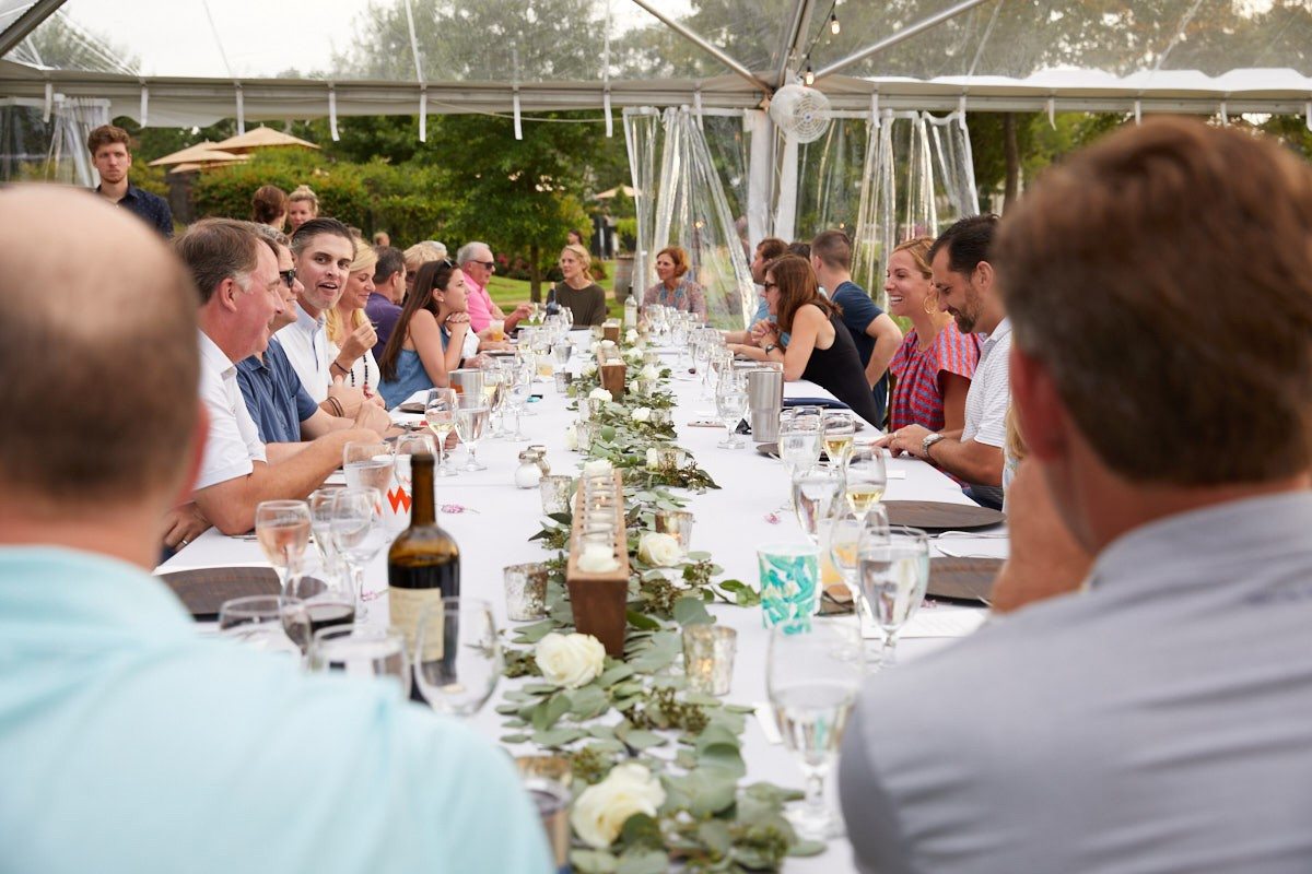 long cove farm to fork table with guests enjoying dinner