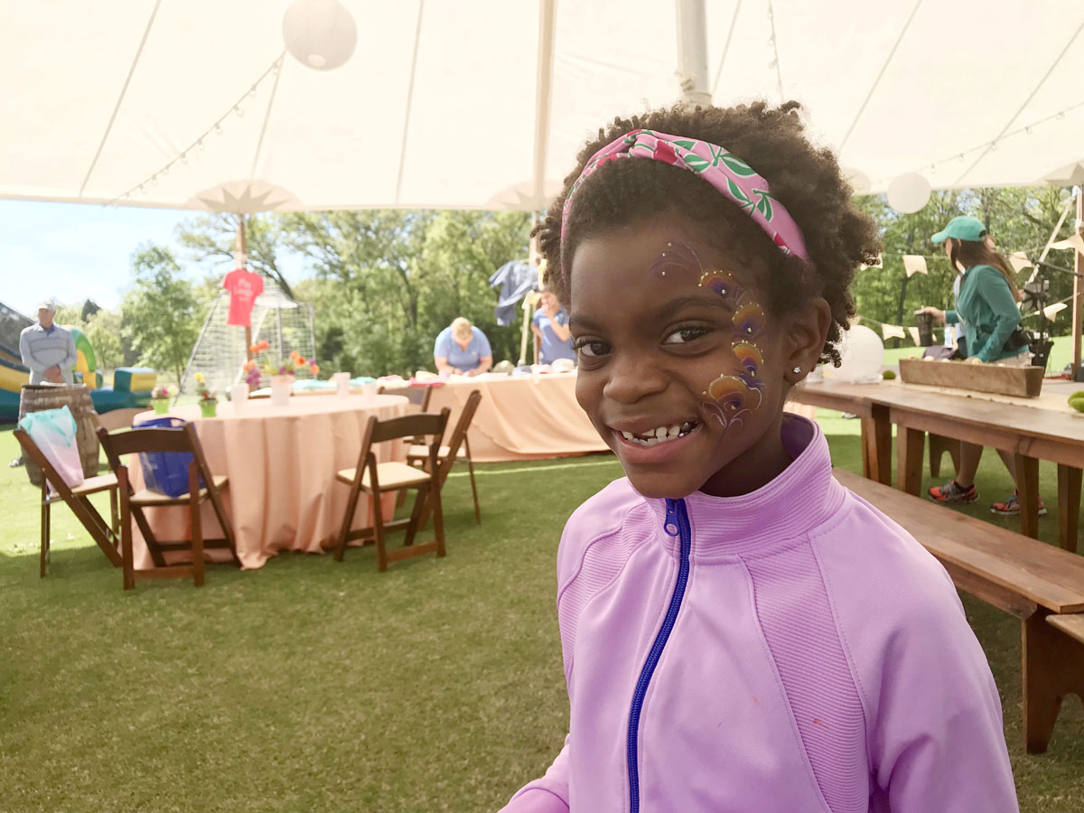 girl gets face painting at long cove easter event