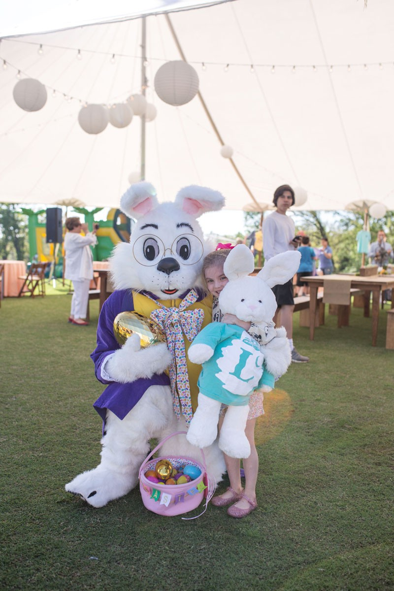 easter bunny poses with stuffed bunny in long cove t shirt