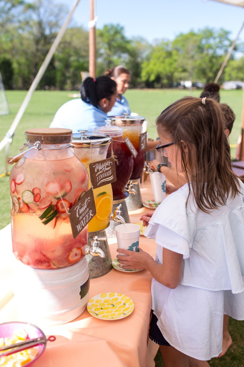 girl getting fruit infused water long cove spring fling