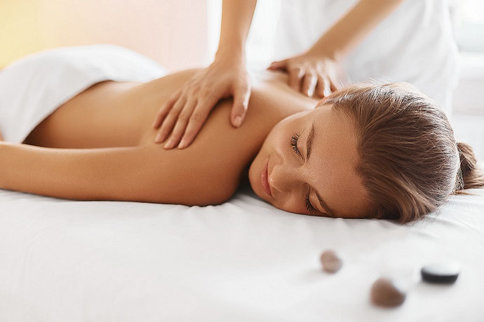 Woman getting a massage highlighting Long Cove Concierge Services