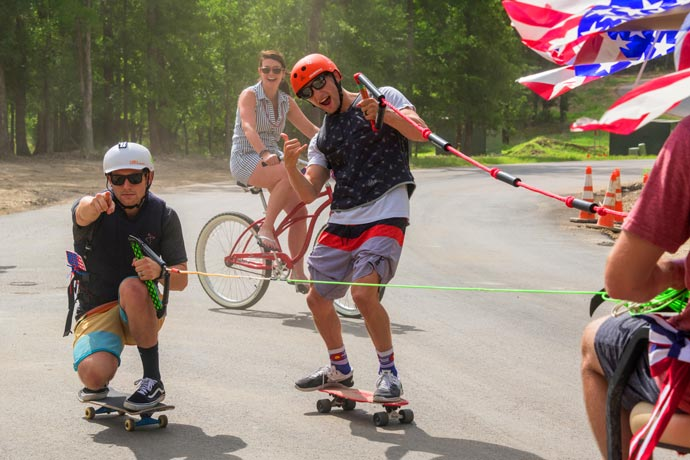 residents posing on skate boards at july 4th party at Long Cove