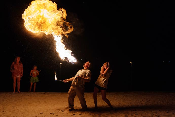 entertainers blowing fire for crowd at Long Cove labor day luau resident event