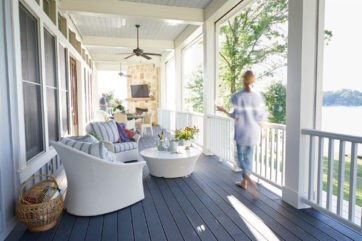 A woman enjoying her beautiful porch in the Long Cove Community on Cedar Creek Lake